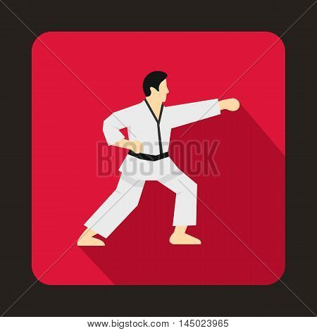 Karate fighter icon in flat style on a crimson background