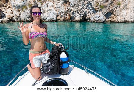 Female scuba diver shows the
