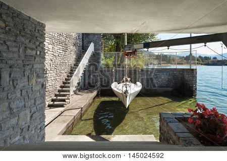 Dock on the lake of an old stone house, outdoors