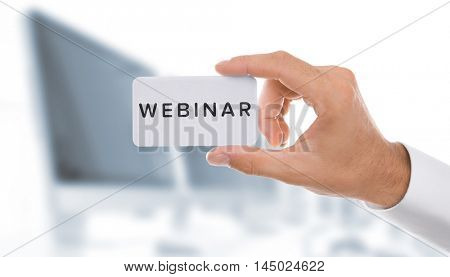 Business trainer with business card, close-up