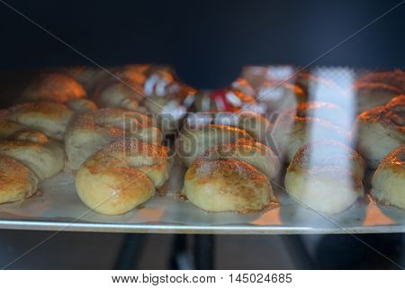 cinnamon rolls and sugar in the oven