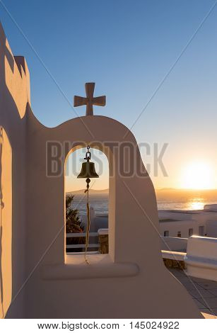 Sunset behind church bell at the Cyclades, Greece