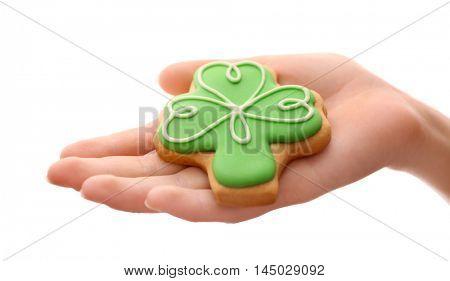 Woman holding decorative cookie. Saint Patrics Day concept