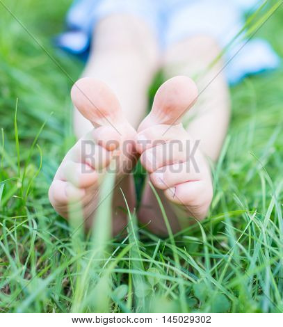 Happy kid in summer beautiful grass