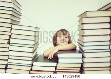 Cute kid with a lot of books