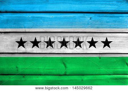 Flag Of Nueva Loja, Ecuador, Painted On Old Wood Plank Background