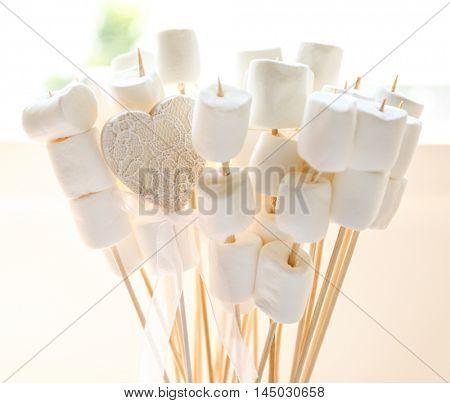 Wedding decorative marshmallow on sticks, closeup