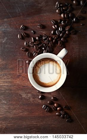 Cup od Espresso Macchiato with Dark Coffee Beans