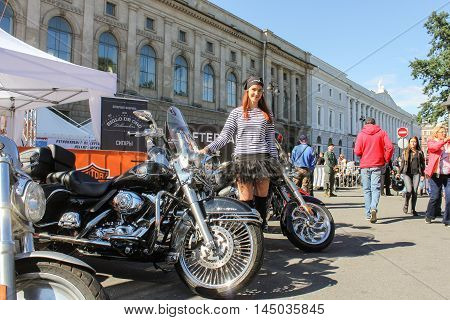 St. Petersburg, Russia - 12 August, Girl in a striped vest on motorbikes background,12 August, 2016. The annual International Festival of Motor Harley Davidson in St. Petersburg Ostrovsky Square.