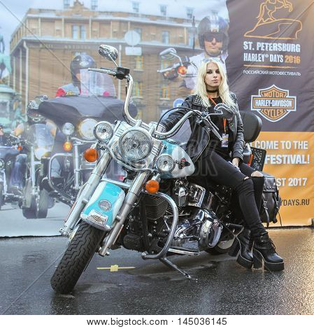 St. Petersburg, Russia - 12 August, Model on the motorcycle,12 August, 2016. The annual International Festival of Motor Harley Davidson in St. Petersburg Ostrovsky Square.