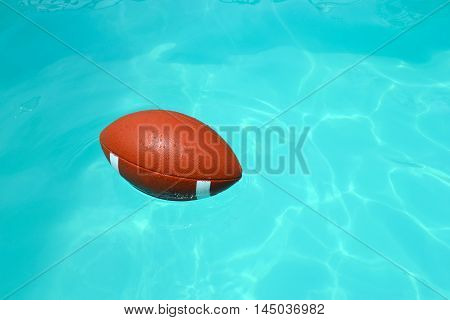 Rugby ball in a blue swimming pool