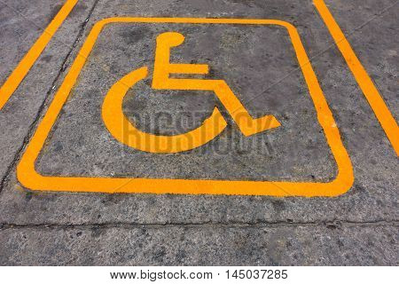 Disabled person parking place permit mark on gas station