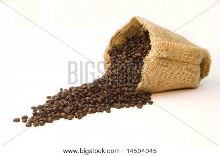 Burlap bag of coffee beans on white background.