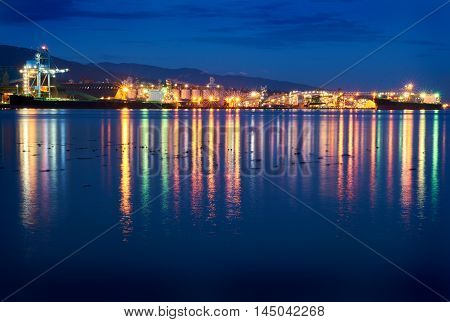 Burrard Inlet Industrial Waterfront. The industrial waterfront of North Vancouver at night. British Columbia, Canada.