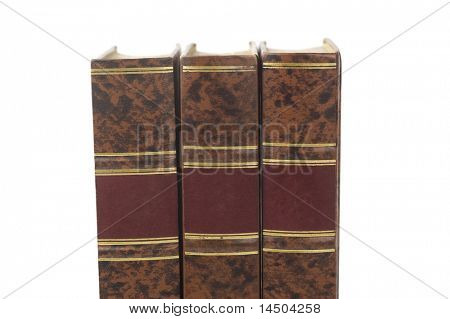 Row of three old books isolated on white background
