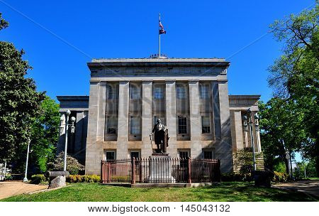 Raleigh North Carolina - April 18 2016: South front of c. 1840 State Capitol Building with statue of George Washington *