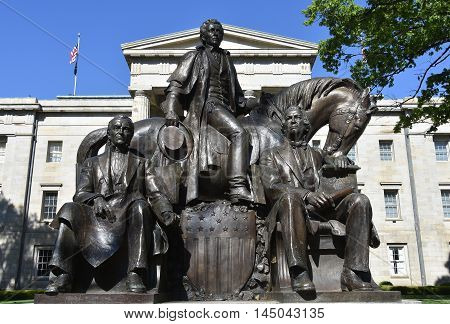 Raleigh. North Carolina - April 18 2016: Native son Presidents sculpture left to right James K. Polk Andrew Jackson and Andrew Johnson) at the North Carolina State Capitol Building