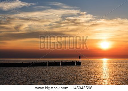 The colors of the sunset over the Baltic Sea in Kolobrzeg in Poland