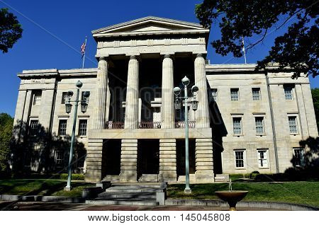 Raleigh North Carolina - April 18 2016: The east front of the c. 1840 North Carolina State House with its neo-classical portico columns and pediment