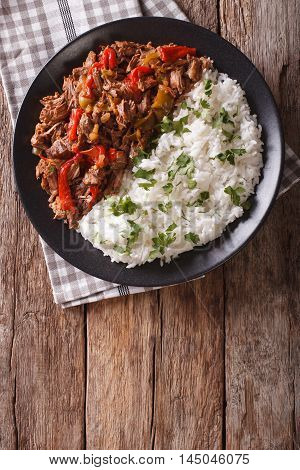 Ropa Vieja: Beef Stew In Tomato Sauce With Vegetables And Rice Garnish. Vertical Top View