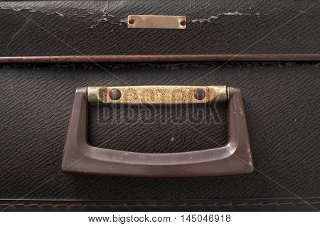 The old handle of old suitcases close up