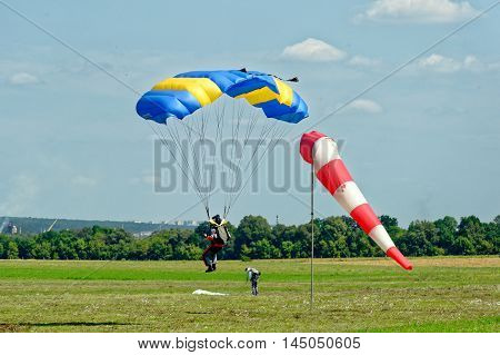 Paraglider landed after the jump at a bright sunny summer day. Active lifestyle, extreme hobbies