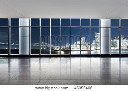 cityscape and skyline of san francisco at night from glass window