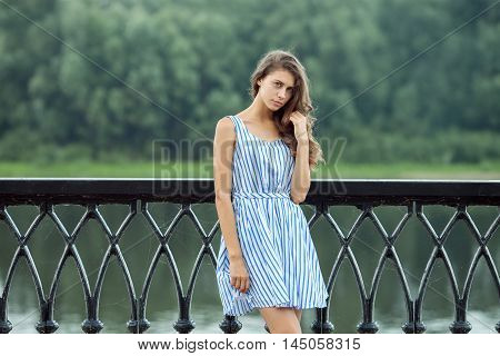 Portrait Young Beautiful Woman In White Blue Striped Dress, Summer Rver Park Outdoors