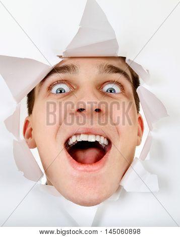 Cheerful Teenager peeking through the Paper Hole