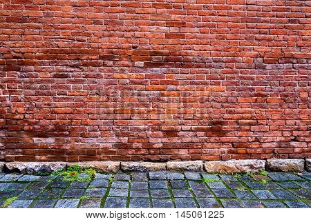 The Old Brick Wall with Cobblestone Road
