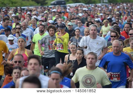 Spring Lake NJ 07762 - May 24 2014. Runners bunched up at the beginning of the annual Spring Lake 5k race. Editorial Use Only.