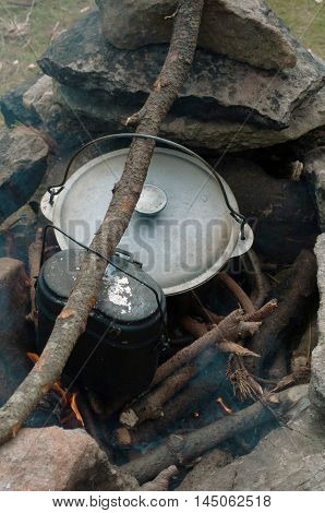 Cooking in a cauldron over an open fire