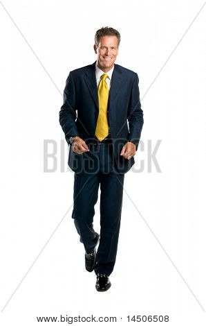 Happy mature businessman walking in front of the camera isolated on white background