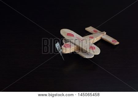 I also know how to fly  toy airplane from rough tree on a dark background. Propeller made of tin.