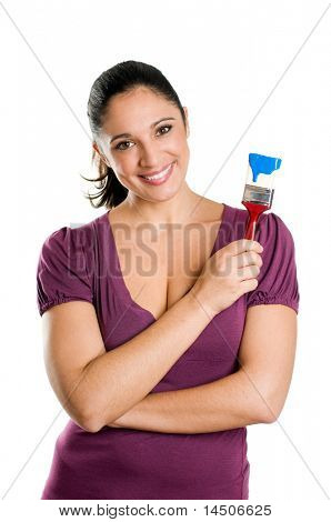 Young attractive woman smiling and holding a blue paintbrush ready for paint