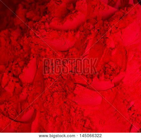 Bright red kumkum powder. Red color pigmet. View from above.