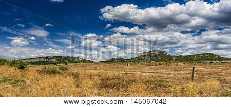 Rocks and grass of Crimean peninsula. Stock photo.