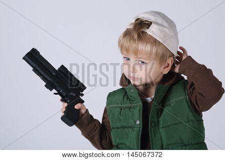 photo of little boy with gun on white