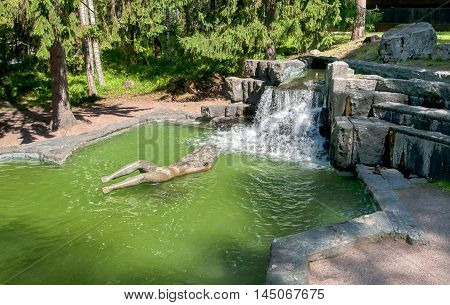 IMATRA, FINLAND - JULY 2, 2016: Maiden of Imatra Sculpture and Fountain in Kruununpuisto Park next to the Imatrankoski Rapid on the Vuoksi River