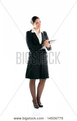 Full length young business woman taking notes on her clipboard isolated on white background