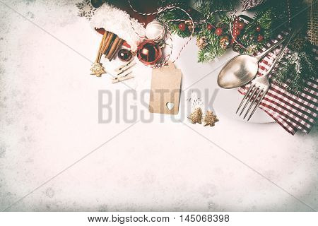 Christmas food concept - plate with fork and spoon with christmas decoration top view with place for text toned