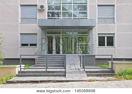 Entrance in Small Condo Building With Disabled Ramp Slope