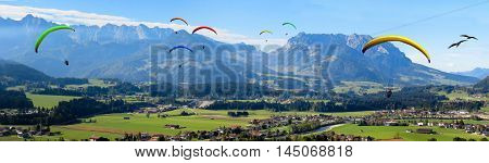 Mountain Landscape With Parachutists In The Sky Panorama