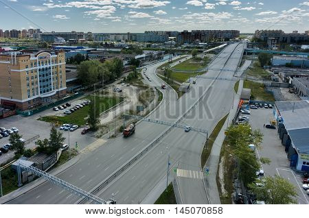 Tyumen, Russia - March 11, 2016: Bird eye view onto road intersection over railways on Montazhnikov street