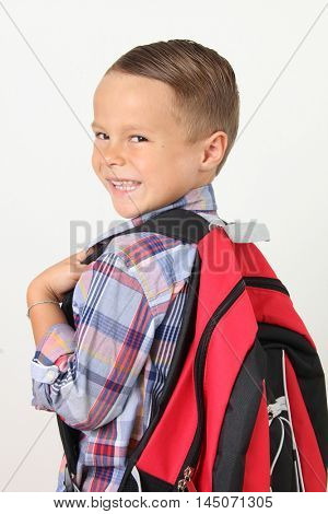 Young boy wearing a backpack. Back to school concept.