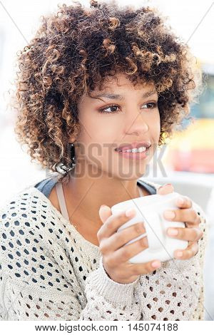Young African American Woman Drinking Coffee.