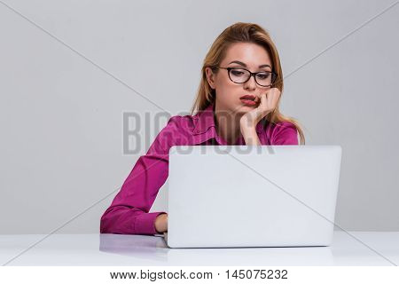 Young businesswoman working at laptop computer. she was tired and looking at monitor