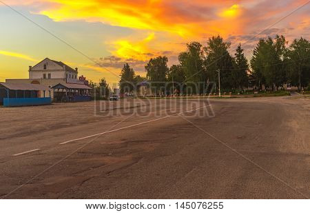 BOROMLYA SUMSKAYA OBLAST UKRAINE - AUGUST 04, 2016: Central street of Boromlya village with roadside market and occasional dealers at August 04, 2016