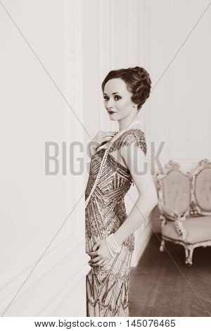 Portrait of young beautiful woman in art-deco style