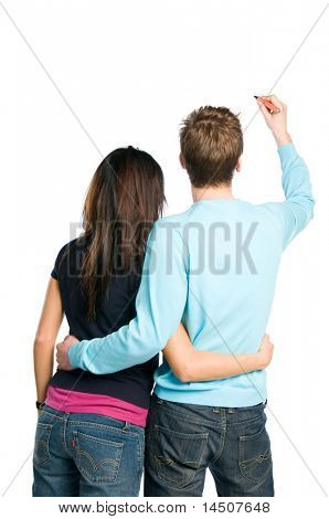 Rear view of young couple writing on blank white board. Compile with your text!